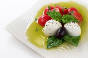 Caprese salad: mozzarella cheese, tomatoes, basil, extra virgin olive oil