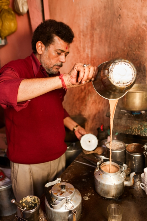 Indian street seller selling tea - masala chai