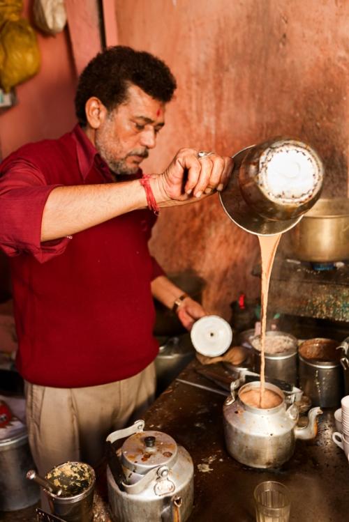 Indian street seller selling tea - masala chai