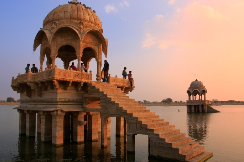 Gadi Sagar temple on Gadisar lake at sunset, Jaisalmer, India